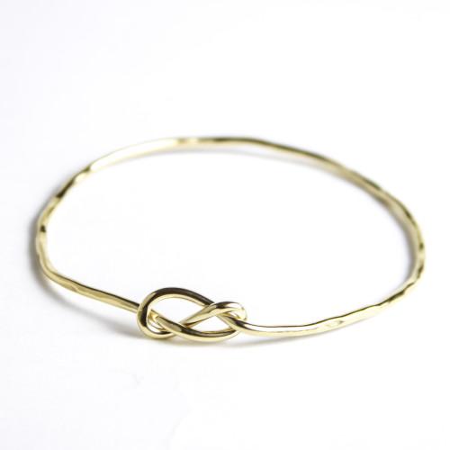 Christina_jervey_handcrafted_jewelry_handmade_silver_gold_loversknot_knot_bracelet_bangle.jpeg